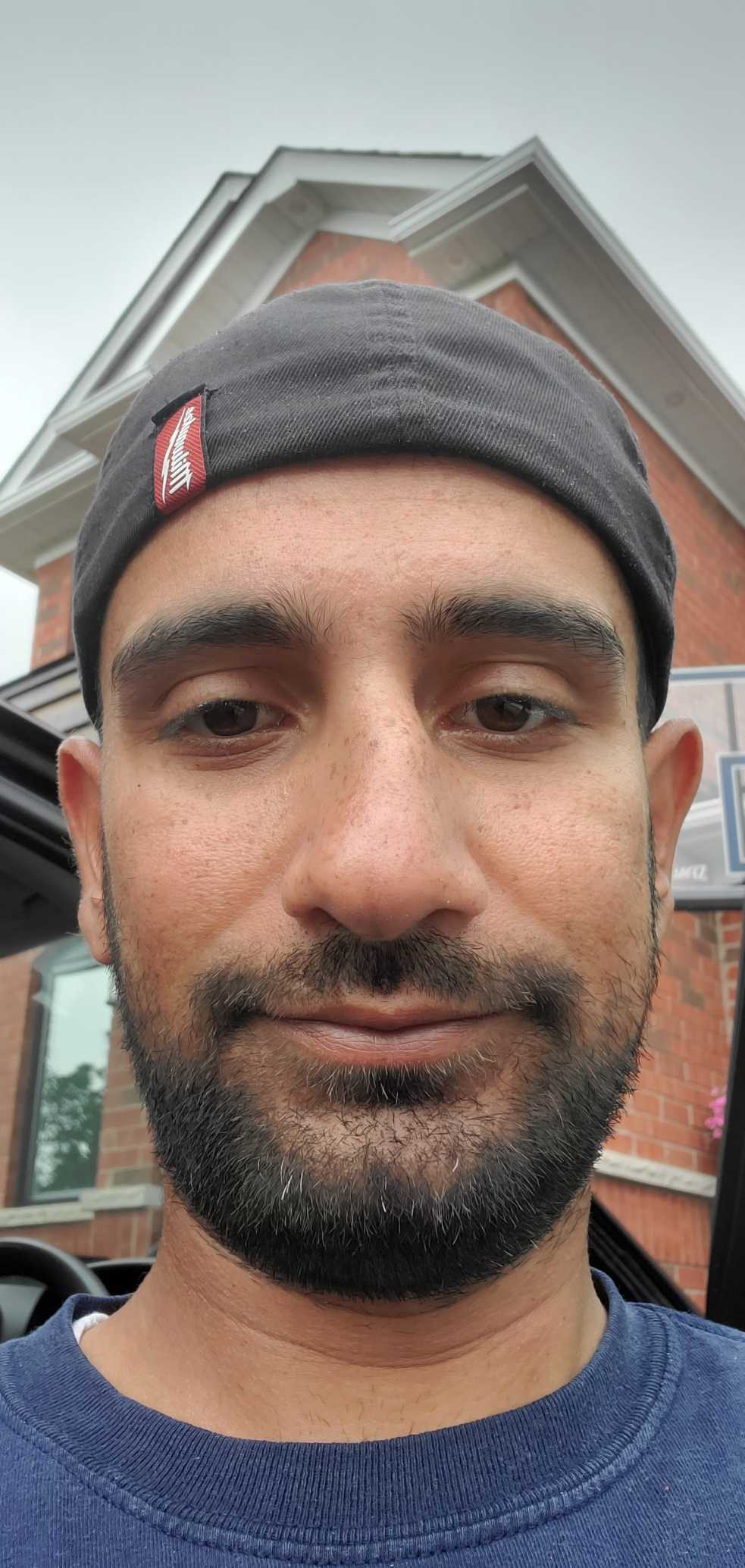 Image of a man with a mustache, beard, and beanie hat.